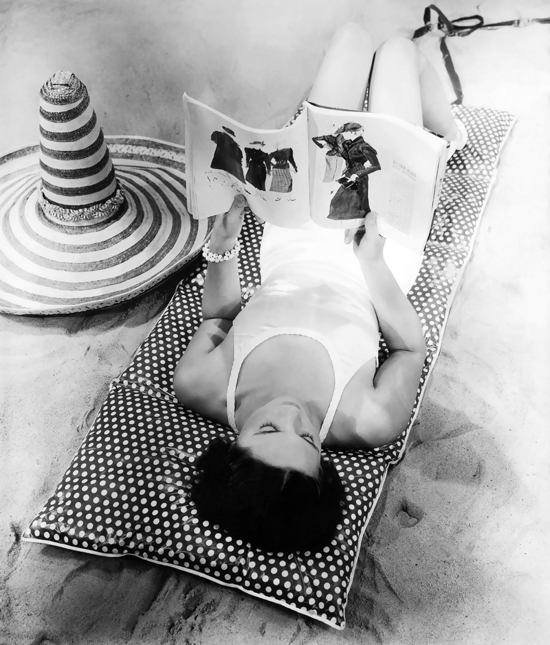 honey-kennedy-peggy-stevenson-reclined-on-a-polka-dot-beach-cushion-reading-vogue-magazine-1935